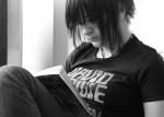 teen (b & w goth) reading